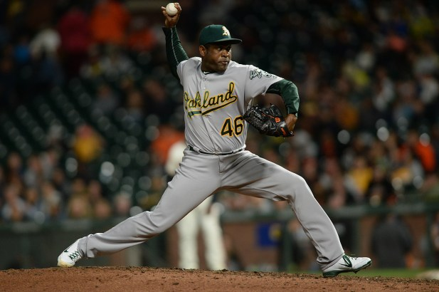 Oakland Athletics relief pitcher Santiago Casilla (46) throws a pitch in the ninth inning as the Oakland Athletics face the San Francisco Giants at AT&T Park in San Francisco, Calif., on Tuesday, August 2, 2017.