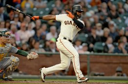 San Francisco Giants right fielder Jarrett Parker (6) doubles in the second inning as the Oakland Athletics face the San Francisco Giants at AT&T Park in San Francisco, Calif., on Thursday, August 3, 2017.