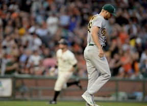Oakland Athletics starting pitcher Kendall Graveman (49) walks back to the mound after giving up a home run in the second inning as the Oakland Athletics face the San Francisco Giants at AT&T Park in San Francisco, Calif., on Thursday, August 3, 2017.