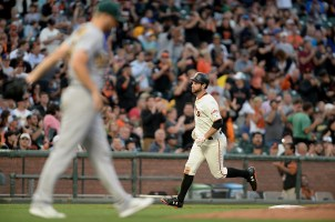 San Francisco Giants first baseman Brandon Belt (9) rounds the bases after a home run in the second inning as the Oakland Athletics face the San Francisco Giants at AT&T Park in San Francisco, Calif., on Thursday, August 3, 2017.