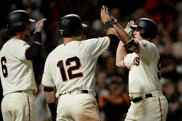 San Francisco Giants relief pitcher Ty Blach (50) hits a home run in the fifth inning as the Oakland Athletics face the San Francisco Giants at AT&T Park in San Francisco, Calif., on Thursday, August 3, 2017.