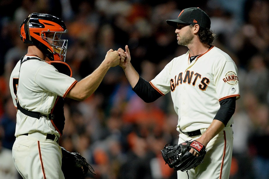 San Francisco Giants relief pitcher Cory Gearrin (62) bumps fists with catcher Nick Hundley (5) after the 11-2 victory over the Oakland Athletics at AT&T Park in San Francisco, Calif., on Thursday, August 3, 2017.