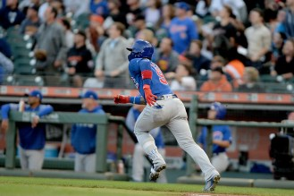 Chicago Cubs shortstop Javier Báez (9) watches the ball sail to the fence in the second inning for an inside the park home run as the Chicago Cubs face the San Francisco Giants at AT&T Park in San Francisco, Calif., on Monday, August 7, 2017.