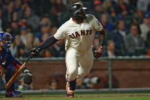 San Francisco Giants third baseman Pablo Sandoval (48) singles in the seventh inning as the Chicago Cubs face the San Francisco Giants at AT&T Park in San Francisco, Calif., on Tuesday, August 8, 2017.