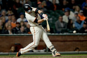 San Francisco Giants first baseman Buster Posey (28) singles in the eighth inning as the Chicago Cubs face the San Francisco Giants at AT&T Park in San Francisco, Calif., on Tuesday, August 8, 2017.