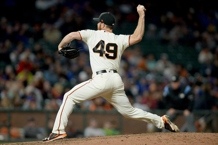 San Francisco Giants relied pitcher Sam Dyson (49) throws a pitch in the ninth inning as the Chicago Cubs face the San Francisco Giants at AT&T Park in San Francisco, Calif., on Tuesday, August 8, 2017.