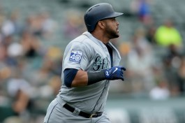 Seattle Mariners designated hitter Nelson Cruz (23) homers in the fifth inning as the Seattle Mariners face the Oakland Athletics at Oakland Coliseum in Oakland, Calif., on Wednesday, August 9, 2017.