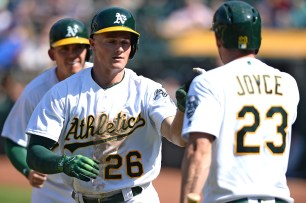 Oakland Athletics third baseman Matt Chapman (26) is congratulated after a two run home run in the eighth inning as the Kansas City Royals face the Oakland Athletics at Oakland Coliseum in Oakland, Calif., on Wednesday, August 16, 2017.