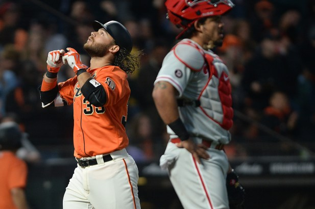 San Francisco Giants shortstop Brandon Crawford (35) hits a two run home run in the third inning as the Philadelphia Phillies face the San Francisco Giants at AT&T Park in San Francisco, Calif., on Friday, August 18, 2017.