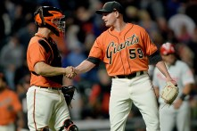 San Francisco Giants relief pitcher Kyle Crick (59) and catcher Nick Hundley (5) shake hands after the 10-2 victory as the Philadelphia Phillies face the San Francisco Giants at AT&T Park in San Francisco, Calif., on Friday, August 18, 2017.