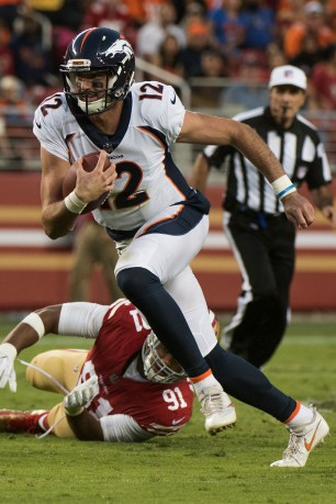 Denver Broncos quarterback Paxton Lynch (12) scrambles in the second quarter of the game against the San Francisco 49ers at Levi's Stadium in Santa Clara, Calif., on August 19, 2017.