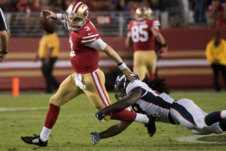 San Francisco 49ers quarterback C.J. Beathard (3) breaks free of a tackle in the second quarter of the game against the Denver Broncos at Levi's Stadium in Santa Clara, Calif., on August 19, 2017.