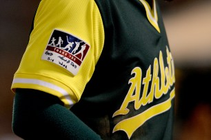 "Oakland Athletics right fielder Matt Joyce (23) gives thanks to ""god, sis, mom and dad and wife on a patch on the sleeve of his uniform as the Texas Rangers face the Oakland Athletics at Oakland Coliseum in Oakland, Calif., on Friday, August 25, 2017."