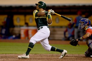 "Oakland Athletics left fielder Khris ""Khrush"" Davis (2) homers in the seventh inning as the Texas Rangers face the Oakland Athletics at Oakland Coliseum in Oakland, Calif., on Friday, August 25, 2017."