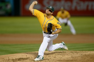 Oakland Athletics starting pitcher Kendall Graveman (49) throws a pitch in the third inning as the Los Angeles Angels face the Oakland Athletics at Oakland Coliseum in Oakland, Calif., on Saturday, April 1, 2017.