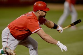 Los Angeles Angels first baseman Albert Pujols (5) reaches for an RBI single in the fifth inning as the Los Angeles Angels face the Oakland Athletics at Oakland Coliseum in Oakland, Calif., on Saturday, April 1, 2017.