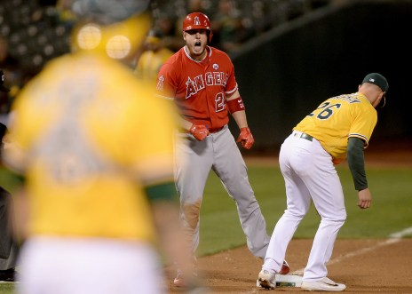 Los Angeles Angels designated hitter C.J. Cron (24) reacts after hitting a triple in the eighth inning as the Los Angeles Angels face the Oakland Athletics at Oakland Coliseum in Oakland, Calif., on Saturday, April 1, 2017.