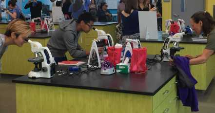 Students and guests check out what's under the microscopes inside of the new Science Garage lab at South San Francisco High School on Tuesday, Sept. 5, 2017.