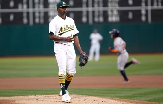 Oakland Athletics starting pitcher Jharel Cotton (45) waits for Houston Astros second baseman Jose Altuve (27) runs the bases after hitting a home run during the first inning as the Houston Astros face the Oakland Athletics at the Oakland Coliseum on Friday September 08, 2017.