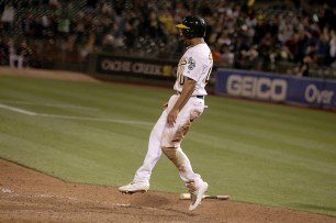 Oakland Athletics shortstop Marcus Semien (10) scores the winning run as the Houston Astros fall to the Oakland Athletics 9-8 at Oakland Coliseum in Oakland, Calif., on Friday, September 8, 2017.