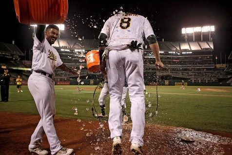 Oakland Athletics second baseman Jed Lowrie (8) is doused after 9-8 walk off win against the Houston Astros at Oakland Coliseum in Oakland, Calif., on Friday, September 8, 2017.