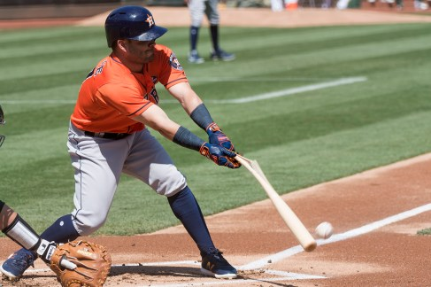 Houston Astros second baseman Jose Altuve (27) breaks his bat hitting a ball foul in the first inning of the game against the Oakland Athletics at the Oakland Coliseum in Oakland, Calif., on September 10, 2017.