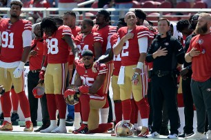 San Francisco 49ers' Eric Reid (35) takes a knee during the National Anthem as the Carolina Panthers face the San Francisco 49ers at Levi's Stadium in Santa Clara, Calif., on Sunday, September 10, 2017.