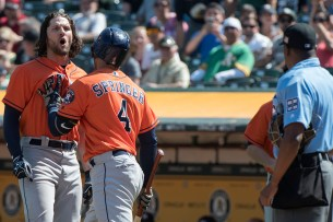 Houston Astros center fielder Jake Marisnick (6) is restrained by right fielder George Springer (4) while yelling athomee plate umpire Ramon De Jesus after striking out looking in the fifth inning of the game against the Oakland Athletics at the Oakland Coliseum in Oakland, Calif., on September 10, 2017.