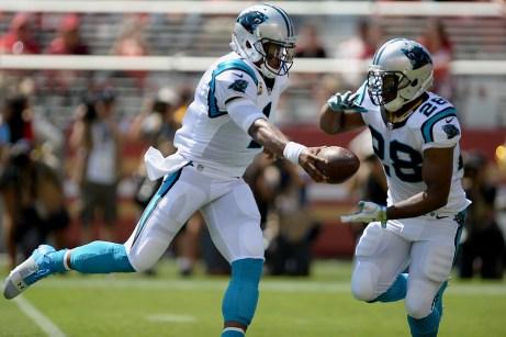 Carolina Panthers starting quarterback Cam Newton (1) hands the ball off to Carolina Panthers' Jonathan Stewart (28) as the Carolina Panthers face the San Francisco 49ers at Levi's Stadium in Santa Clara, Calif., on Sunday, September 10, 2017.