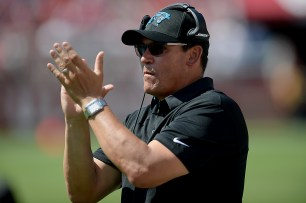 Carolina Panthers head coach Ron Rivera applauds a touchdown in the first half as the Carolina Panthers face the San Francisco 49ers at Levi's Stadium in Santa Clara, Calif., on Sunday, September 10, 2017.