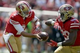 San Francisco 49ers starting quarterback Brian Hoyer (2) hands off to San Francisco 49ers' Carlos Hyde (28) as the Carolina Panthers face the San Francisco 49ers at Levi's Stadium in Santa Clara, Calif., on Sunday, September 10, 2017.