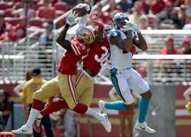 San Francisco 49ers' Jaquiski Tartt (29) brings down an interception in the first half as the Carolina Panthers face the San Francisco 49ers at Levi's Stadium in Santa Clara, Calif., on Sunday, September 10, 2017.