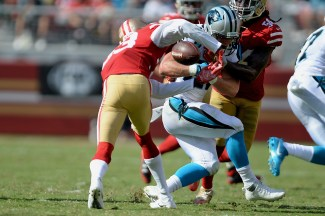 Carolina Panthers' Christian McCaffrey (22) is stripped by San Francisco 49ers' Rashard Robinson (33) in the second half as the Carolina Panthers face the San Francisco 49ers at Levi's Stadium in Santa Clara, Calif., on Sunday, September 10, 2017.