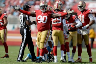 San Francisco 49ers' Earl Mitchell (90) reacts after a fumble recovery as the Carolina Panthers face the San Francisco 49ers at Levi's Stadium in Santa Clara, Calif., on Sunday, September 10, 2017.