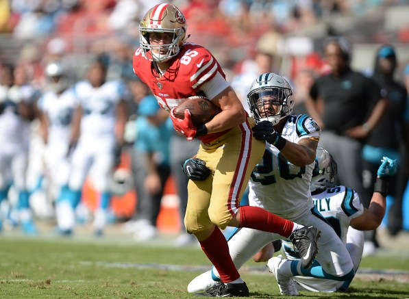 San Francisco 49ers' Garrett Celek (88) spins around for extra yardage after a catch in the second half as the Carolina Panthers face the San Francisco 49ers at Levi's Stadium in Santa Clara, Calif., on Sunday, September 10, 2017.