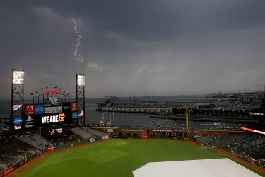 Lightning strikes over the SF Bay during a game delay as the Los Angeles Dodgers face the San Francisco Giants at AT&T Park in San Francisco, Calif., on Monday, September 11, 2017.