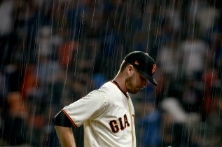 San Francisco Giants starting pitcher Chris Stratton (34) leaves the game during a downpour in the first inning as the Los Angeles Dodgers face the San Francisco Giants at AT&T Park in San Francisco, Calif., on Monday, September 11, 2017.
