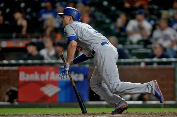 Los Angeles Dodgers shortstop Corey Seager (5) connects for an RBI single in the fourth inning as the Los Angeles Dodgers face the San Francisco Giants at AT&T Park in San Francisco, Calif., on Monday, September 11, 2017.