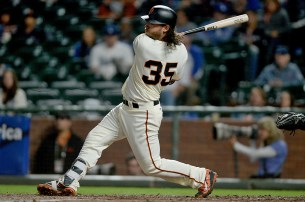 San Francisco Giants shortstop Brandon Crawford (35) singles in the fourth inning as the Los Angeles Dodgers face the San Francisco Giants at AT&T Park in San Francisco, Calif., on Monday, September 11, 2017.