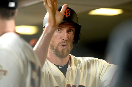 San Francisco Giants right fielder Hunter Pence (8) scores in the fifth inning as the Los Angeles Dodgers face the San Francisco Giants at AT&T Park in San Francisco, Calif., on Monday, September 11, 2017.