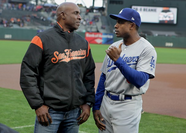 San Francisco Giants special advisor to CEO Barry Bonds talks with Los Angeles Dodgers left fielder Curtis Granderson (6) before the Los Angeles Dodgers face the San Francisco Giants at AT&T Park in San Francisco, Calif., on Wednesday, September 13, 2017.