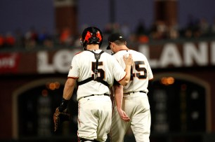 San Francisco Giants catcher Nick Hundly (5) talks with pitcher Matt Moore (45) during the first inning as the Los Angeles Dodgers face the San Francisco Giants at the AT&T Park on Wednesday September 13, 2017.
