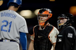 San Francisco Giants catcher Nick Hundley (5), Los Angeles Dodgers pitcher Yu Darvish (21) and home plate umpire Greg Gibson (53) reacts after Darvish attempted to bunt in the fourth inning as the Los Angeles Dodgers face the San Francisco Giants at AT&T Park in San Francisco, Calif., on Wednesday, September 13, 2017.