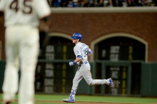 Los Angeles Dodgers center fielder Cody Belinger (35) rounds the bases after a home run in the fifth inning as the Los Angeles Dodgers face the San Francisco Giants at AT&T Park in San Francisco, Calif., on Wednesday, September 13, 2017.