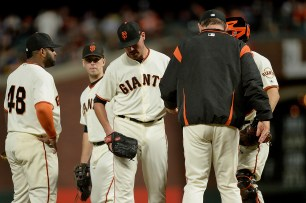 San Francisco Giants pitcher Matt Moore (45) is removed from the game by San Francisco Giants manager Bruce Bochy (15) in the fifth inning as the Los Angeles Dodgers face the San Francisco Giants at AT&T Park in San Francisco, Calif., on Wednesday, September 13, 2017.