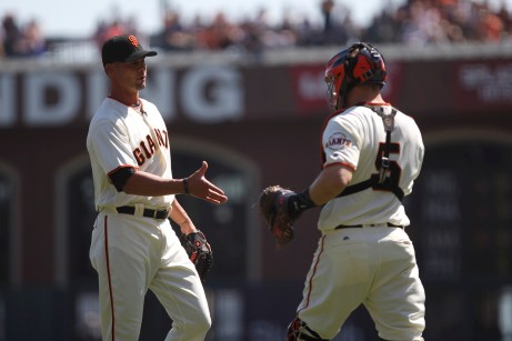 San Francisco Giants former pitcher Ryan Vogelsong (32) shakes hands with San Francisco Giants catcher Nick Hundly (5) after throwing a pitch during his retirement ceremony before the game against Arizona Diamondbacks at the AT&T Park on Sunday September 17, 2017.
