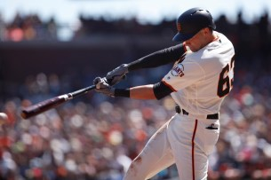 San Francisco Giants third baseman Ryder Jones (63) hits a base hit to get bases loaded in the first inning as the Arizona Diamondbacks face the San Francisco Giants at the AT&T Park on Sunday September 17, 2017.