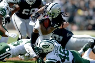 Oakland Raiders running back Marshawn Lynch (24) runs the ball in the first half as the New York Jets face the Oakland Raiders at Oakland Coliseum in Oakland, Calif., on Sunday, September 17, 2017.