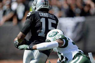 Oakland Raiders wide receiver Michael Crabtree (15) scores a touchdown in the first half as the New York Jets face the Oakland Raiders at Oakland Coliseum in Oakland, Calif., on Sunday, September 17, 2017.