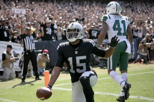Oakland Raiders wide receiver Michael Crabtree (15) scores a touchdown in the first quarter as the New York Jets face the Oakland Raiders at Oakland Coliseum in Oakland, Calif., on Sunday, September 17, 2017.